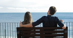 Woman rejecting a friend in first date. Back view of a woman rejecting a friend hug during first date on the beach stock footage