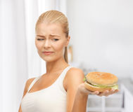 Woman rejecting junk food Royalty Free Stock Photo