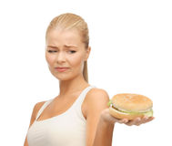 Woman rejecting junk food stock images