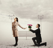 Woman rejecting man with flowers Stock Image