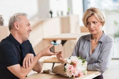 Woman rejecting present from man stock image