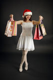 Woman rejoices to Christmas purchases Stock Image