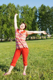 Woman rejoices to good weather Royalty Free Stock Images