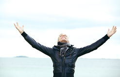 Woman rejoicing with arms outspread Stock Photo