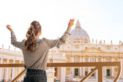 Woman rejoicing in front of basilica di san pietro Royalty Free Stock Photos