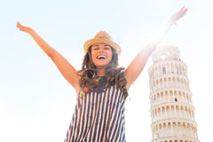 Woman rejoicing in front of leaning tower of pisa Royalty Free Stock Photos