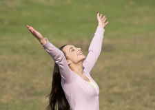 Woman rejoicing on a meadow Royalty Free Stock Image