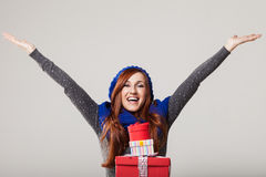 Excited woman with presents Royalty Free Stock Photos