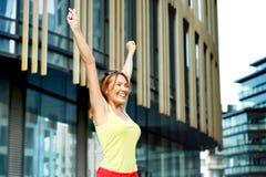 Woman rejoicing success stock photos