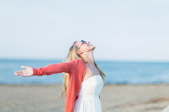 Woman  rejoicing at seaside Stock Images