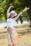 Woman relasing in woods Royalty Free Stock Images