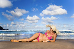 Woman Relax. Woman in pink bikini relaxing on sand Royalty Free Stock Photos