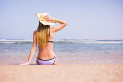 Woman relax on the beach in swimsuit and hat. Summer vocation Stock Photography