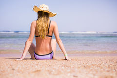 Woman relax on the beach in swimsuit and hat. Summer vocation Stock Images