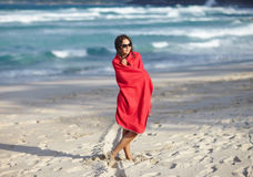 Woman relax on the beach wrapped in towel Royalty Free Stock Photos