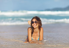 Woman relax on the beach wrapped in towel Stock Photos