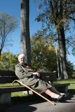 Woman relax on a bench royalty free stock photos