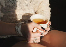 Woman relax with cup of tea in sunlight Stock Images