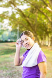 Woman relax after exercise in the garden Royalty Free Stock Image