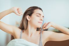 Woman wakes up in bed in the morning stock photos