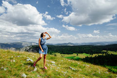 Woman relax on hill with exciting landscape in mountains Stock Photos
