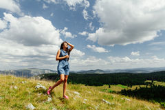Woman relax on hill with exciting landscape in mountains Royalty Free Stock Photo