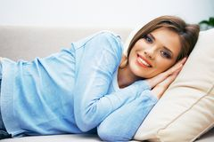 Woman relax at home. Young beautiful woman lying on sofa Stock Image