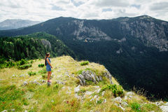Woman relax and look at fascinating landscape of mountains Royalty Free Stock Photos