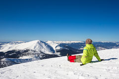 Woman relax in mountains during winter hiking. Beautiful winter nature at sunny day in mountains Stock Photography
