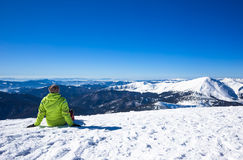 Woman relax in mountains during winter hiking Royalty Free Stock Image