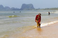 Woman relax outdoor with dog and hat on beach. At Bang Beot beach, Chumphon Province Thailand Royalty Free Stock Photo