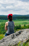 Woman relax sitting on the rock Stock Photography