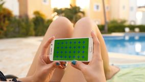 Woman relax on sunbath in swimming pool with using mobile phone stock video