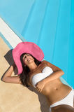 Woman relax sunbathing at poolside Royalty Free Stock Image