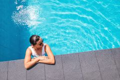 Woman relax in swimming pool Royalty Free Stock Photos