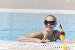 Woman relax on swimming pool Stock Photos