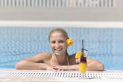 Woman relax on swimming pool Stock Images