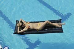 Woman relax on swimming pool Royalty Free Stock Image