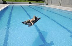 Woman relax on swimming pool Royalty Free Stock Photos