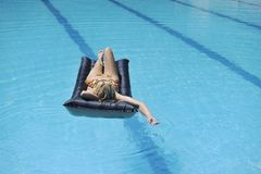 Woman relax on swimming pool Stock Photo