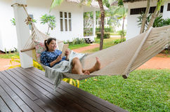 Woman relax time looking tablet Stock Images