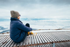 Woman relax in top view point with mountain city winter panorame Royalty Free Stock Photos