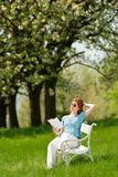 Woman relax under blossom tree in summer Royalty Free Stock Photo