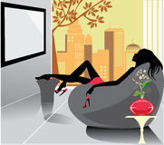 Woman relaxation in a chair Stock Images