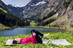 Woman in relaxation pose in yoga outdoors Stock Image