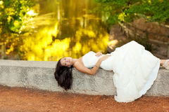 Woman relaxed in autumn golden forest river Royalty Free Stock Photography