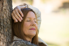 Woman relaxed closed eyes outdoors Royalty Free Stock Photo