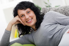 Woman relaxed lying on couch at home Royalty Free Stock Photography