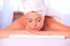 Woman relaxed on a massage table Stock Images
