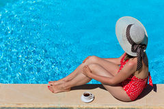 Woman relaxed by the pool with coffee Stock Photography